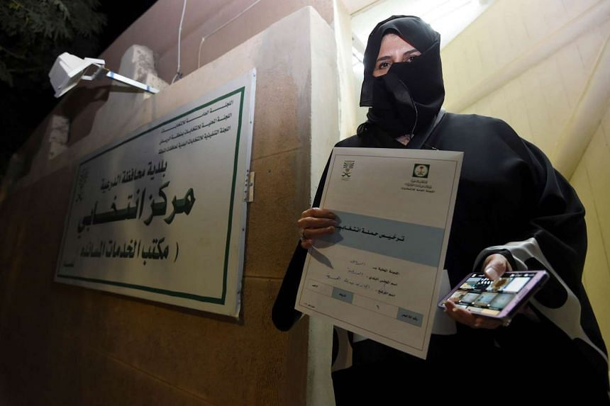 Aljazi al-Hussaini, a candidate for the municipal council in the town of Diriyah, showing her electoral campaign licence on Nov 29.