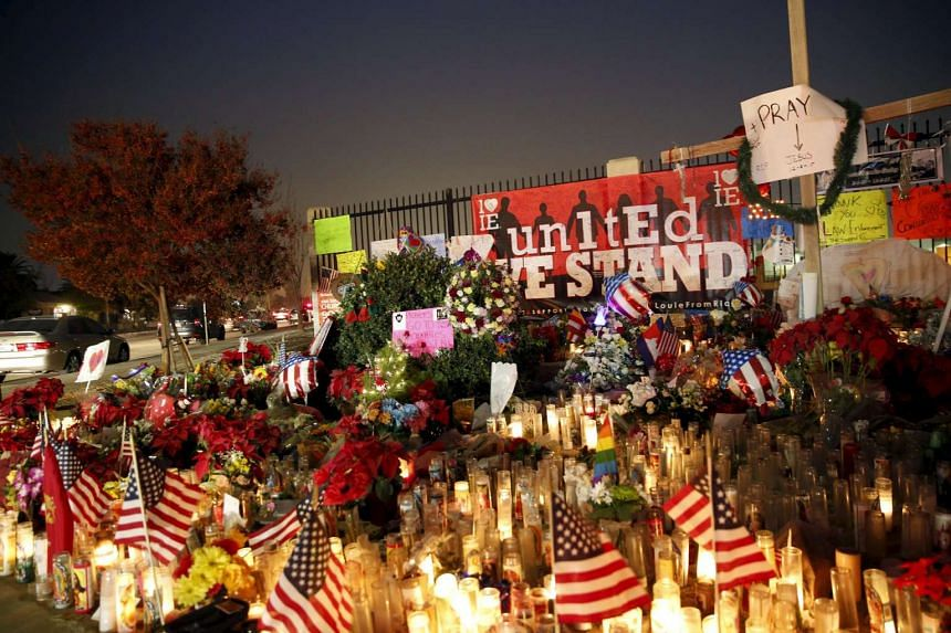 Flowers and candles are displayed at a makeshift memorial after the shooting in San Bernardino, California, on Dec 10.