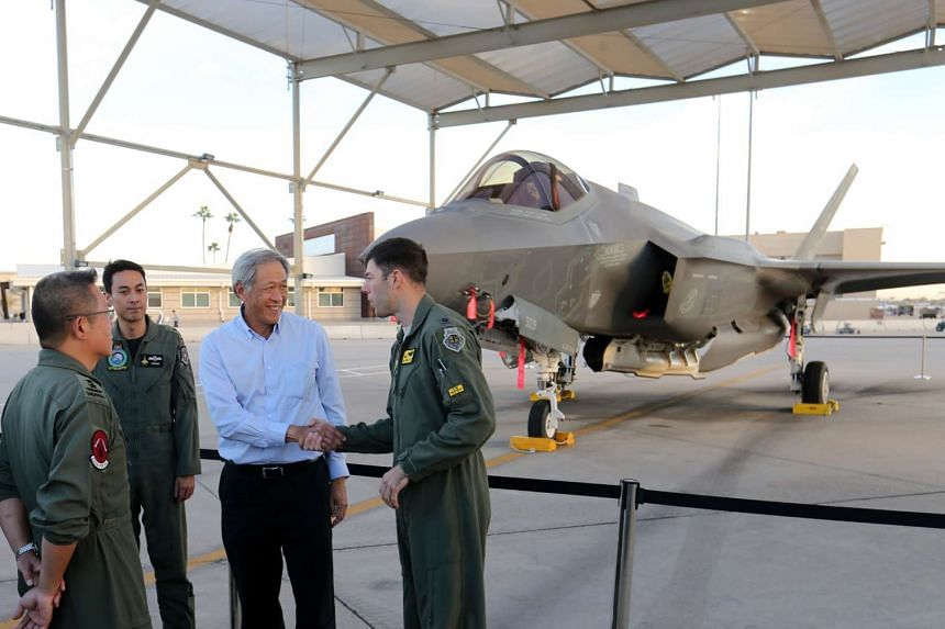 Defence Minister Dr Ng Eng Hen is briefed while viewing the Lockheed Martin F-35A at Luke Air Force Base.