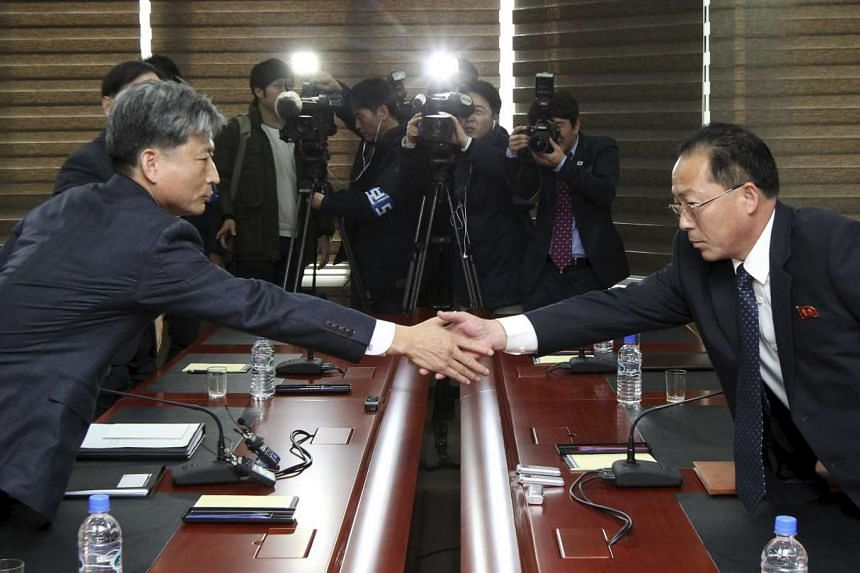 South Korean Vice-Unification Minister Hwang Boo Gi (left) shaking hands with his North Korean counterpart Jon Jong Su during their meeting at the Kaesong Industrial Complex in Kaesong, North Korea, on Dec 11, 2015.