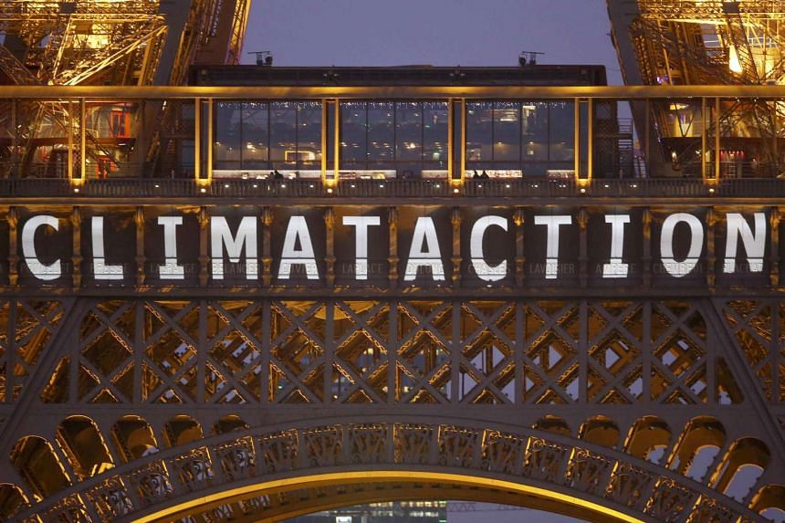"""The slogan """"Climate action"""" is projected on the Eiffel Tower as part of the World Climate Change Conference 2015 (COP21) in Paris, France, on Dec 11, 2015."""