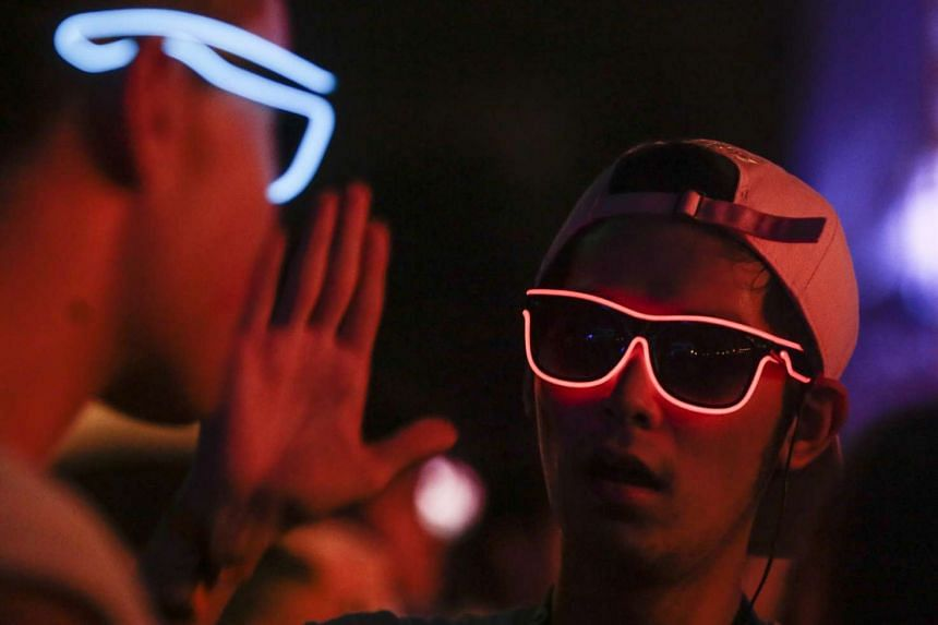 Partygoers wearing illuminated spectacle frames at ZoukOut on Dec 11.