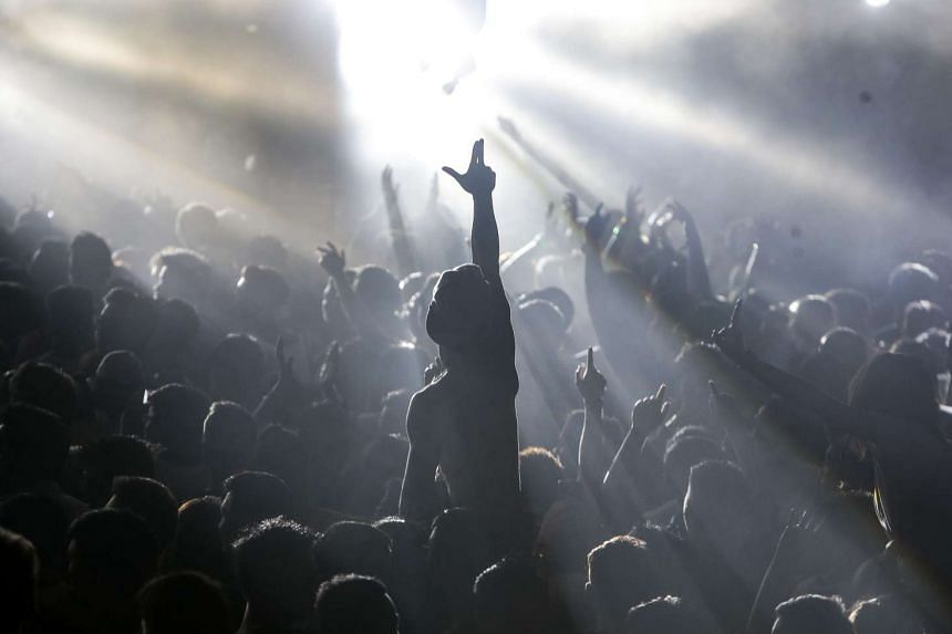 Revellers dancing at the ZoukOut music festival held on Sentosa on Dec 11.