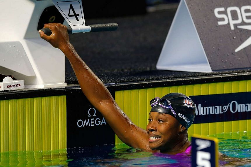 Simone Manuel reacts after winning the Women's 100m Freestyle.