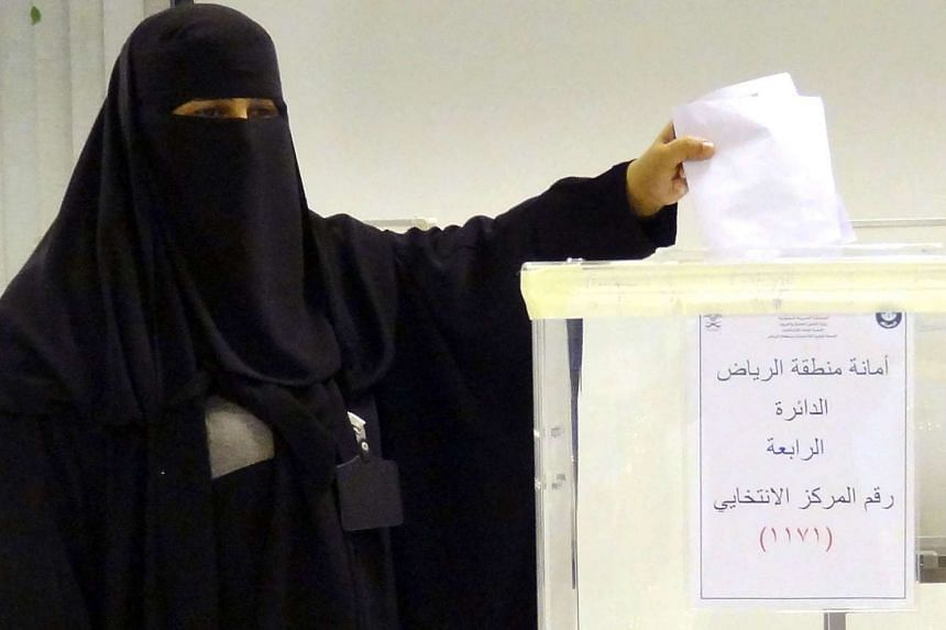 A Saudi woman casting her ballot in an election centre in the Saudi capital of Riyadh, on Dec 12, 2015. Saudi women were allowed to vote in elections for the first time ever, in a tentative step towards easing widespread sex discrimination in the ult