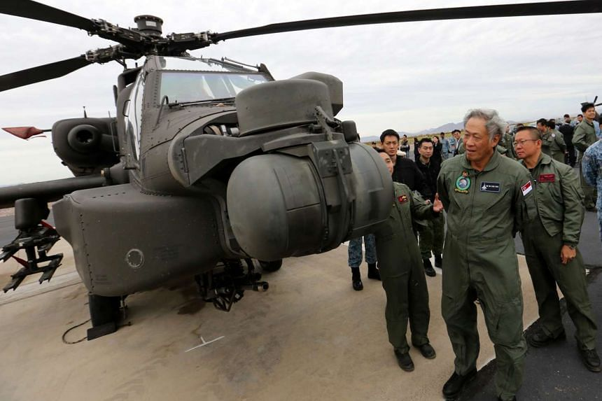 Defence Minister Ng Eng Hen inspects the AH-64D Apache at the Barry M Goldwater Air Force Range at Gila Bend.