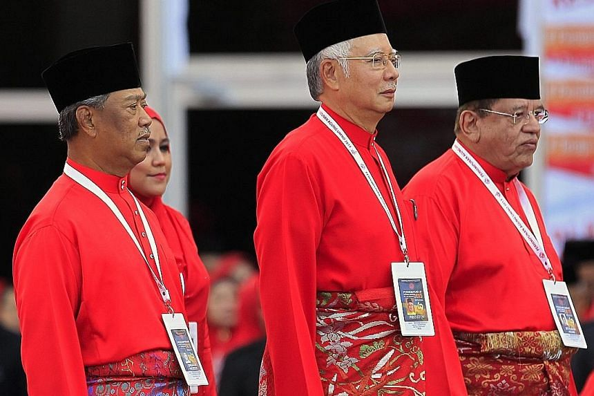 Malaysian PM Najib Razak (centre) with his party deputy Muhyiddin Yassin (left) and secretary-general Tengku Adnan Tengku Mansor at the Umno general assembly's opening ceremony on Thursday.