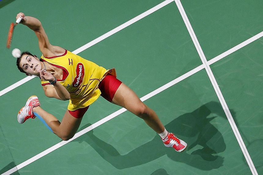 Spain's Carolina Marin (right) during her loss to Japan's Nozomi Okuhara in their women's singles match at the BWF Dubai World Superseries Finals tournament.