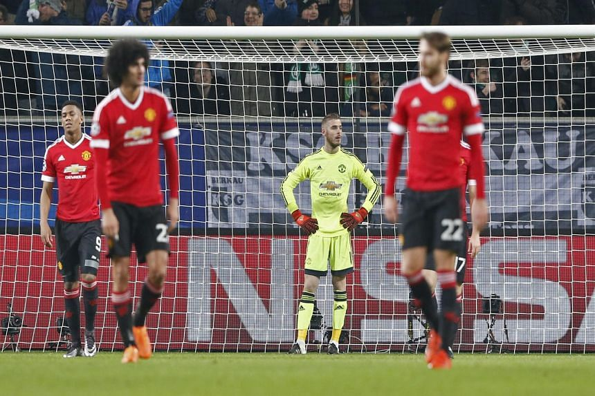 Manchester United's Marouane Fellaini, David de Gea and Nick Powell look dejected after Naldo scored the third goal in Wolfsburg's 3-2 win against Manchester United in the Champions League game on Tuesday.