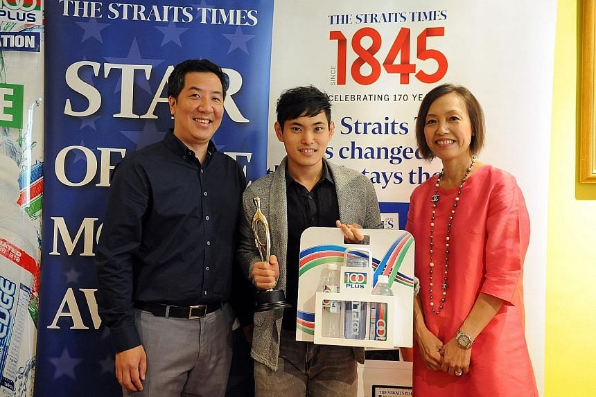 Tan Xiang Tian with Marc Lim, sports editor of The Straits Times, and Jennifer See, general manager of F&N. Tan is The Straits Times' Star of the Month for November for winning gold at the World Championships.
