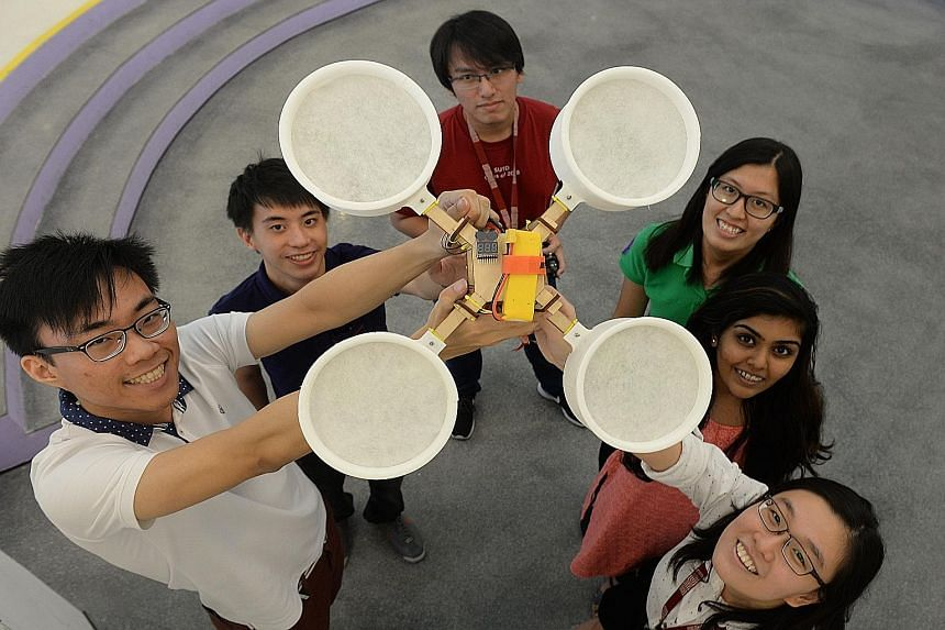 Inspired by the haze, SUTD students (from left) Chew Cheng York, Khaw Jien Yi, Goh Xin Ro, Tan Yu Da, Aastha Chouhan and Tan Yee Ying came up with Cleansecopter, a drone that sucks up haze particles.