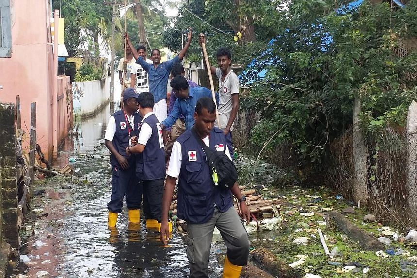 A Singapore Red Cross Response Team surveying the situation in Thiruninravur, Chennai.