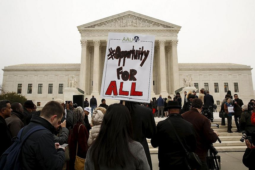 Demonstrators gathering outside the Supreme Court in Washington on Wednesday as the case on the University of Texas at Austin's affirmative action policy for admissions was being heard.