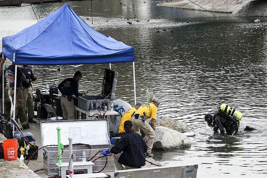 FBI divers searching for evidence in Seccombe Lake, which is near the scene of last week's massacre in San Bernardino.