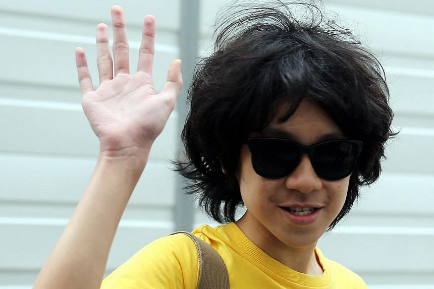 Blogger Amos Yee arriving at the State Courts on May 27.