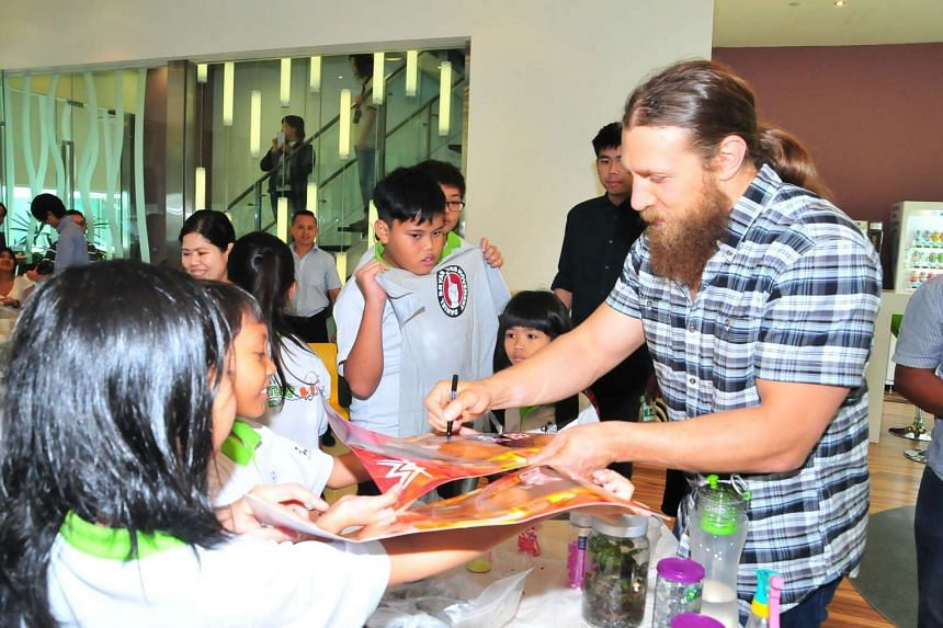 WWE's Daniel Bryan signing autographs for children from Central Singapore CDC's Nurture 2.0 programme on Dec 9, 2015.