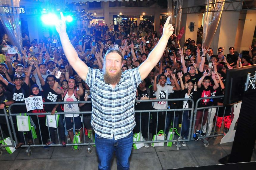Leader of the Yes movement, WWE superstar Daniel Bryan poses with fans at a meet and greet at Bugis Junction on Dec 9, 2015