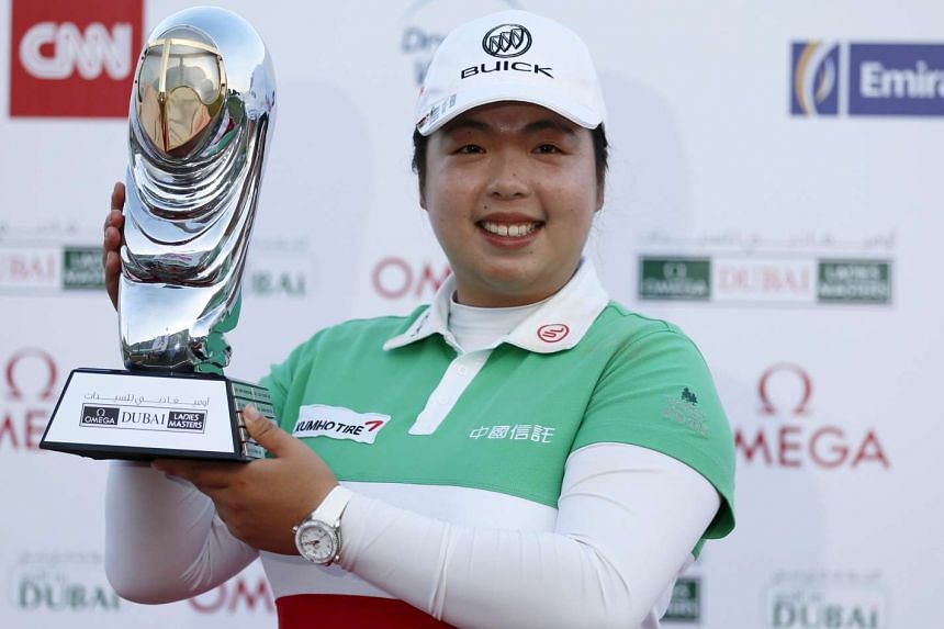 Feng Shanshan of China with her trophy after winning the Dubai Ladies Masters.