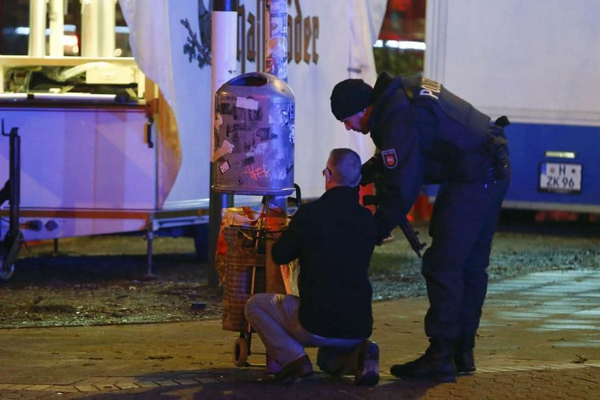 Police officers inspect suspect item outside the stadium before the match.