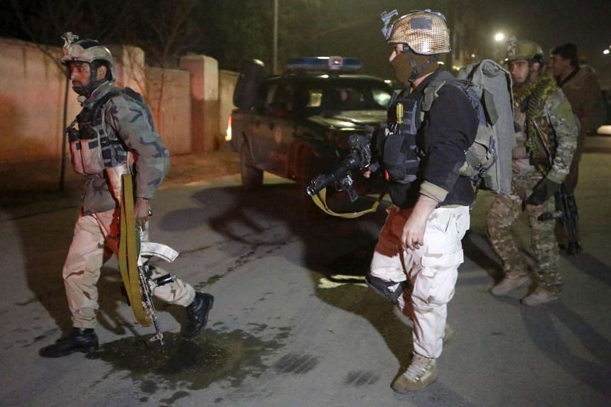 Members of Afghan Crisis Response Unit arrive at the site of the attack in Kabul.