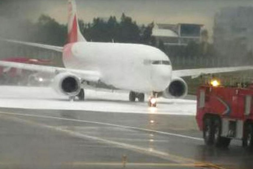 The Fuzhou Airlines planed covered in foam after firefighters mistook it for another plane that was emitting sparks from its engine.