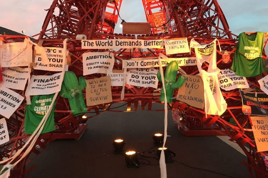 Climate demands left by protesters on a model of the Eiffel Tower at the conference venue.