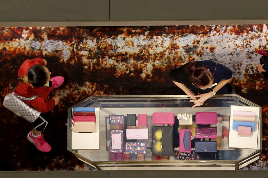 Luxury bags on sale at a shopping mall in Beijing. China's affluence is driving a structural shift towards services in Asean economies, analysts say.