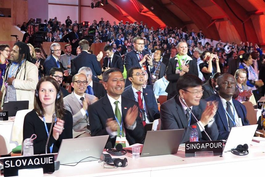 Dr Vivian Balakrishnan (foreground, second from left) attends the World Climate Change Conference 2015 in Paris.