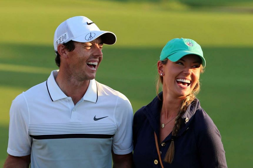 Rory McIlroy of Northern Ireland celebrates with girlfriend Erica Stoll after winning the DP World Tour Golf Championship in Dubai.