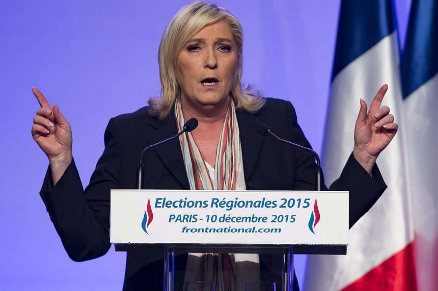 Marine Le Pen, leader of French far-right political party Front National, delivers a speech in Paris on Dec 10, 2015.