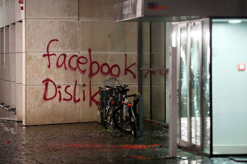 """The message """"facebook Dislike"""" is written on the wall of a building where US social media giant Facebook has its German headquarters in Hamburg, northern Germany, on Dec 13, 2015."""