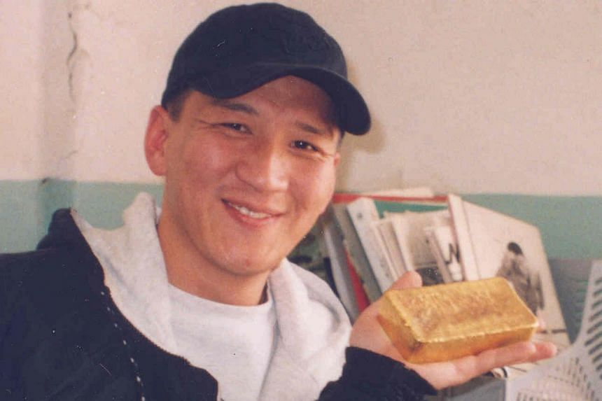 Mr Tumur at a gold mine in 2003 (above) and during an exploration field trip to eastern Mongolia in 2005. He has a master's in mining engineering from the Colorado School Of Mines.