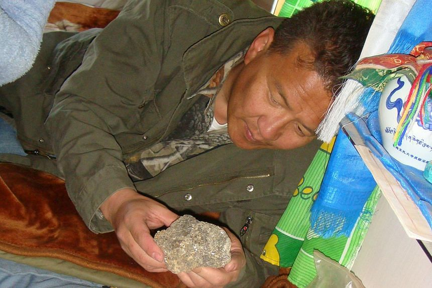 Mr Tumur at a gold mine in 2003 and during an exploration field trip to eastern Mongolia in 2005. He has a master's in mining engineering from the Colorado School Of Mines.