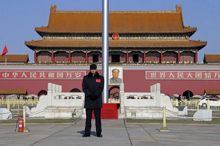 A security guard keeps watch at Tiananmen Square in Beijing, Dec 10, 2015.