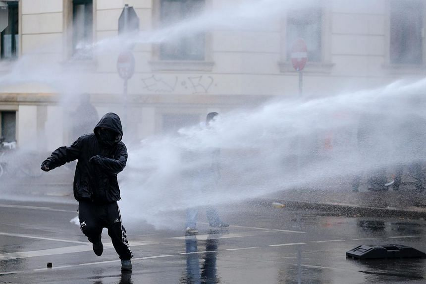 German police use water guns against left-wing counter-protesters at a rally of the party 'Die Rechte' (The Right) in Leipzig, Germany.