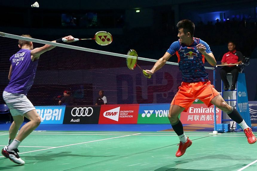 World Number One Chen Long (right) of China returns a shot against Viktor Axelsen of Denmark during their men's single semi-final match in the Dubai World Superseries Finals badminton tournament.