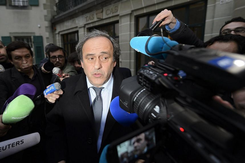 Uefa president Michel Platini (centre) leaves after a hearing at the international Court of Arbitration for Sport (CAS) in Lausanne, Switzerland.