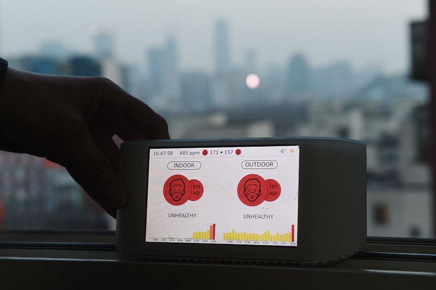In this photo taken on Dec 11, 2015, Yann Boquillod displays an Airvisual air quality monitor in Beijing. Airvisual is a China-based social enterprise developing technology for a global pollution monitoring network.