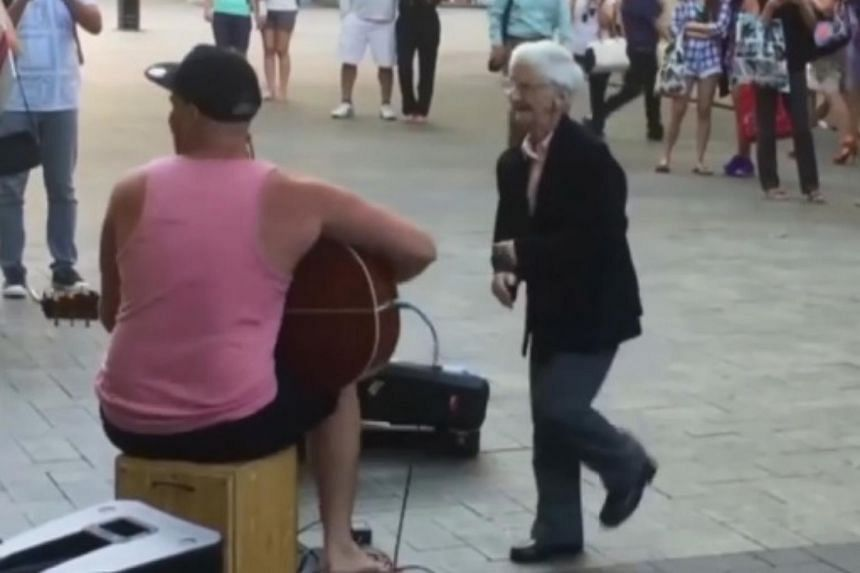 A video of a 77-year-old woman caught dancing to music on a Perth street has gone viral.
