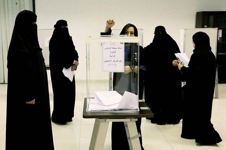 Saudi women cast their votes at a polling station in the Kingdom's municipal elections, in Riyadh, Saudi Arabia.