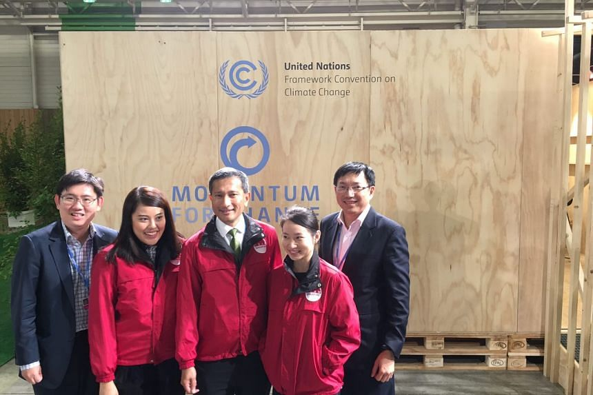 Dr Vivian Balakrishnan (centre), told the final plenary session that Singapore was proud to be part of a major global agreement to help  combat climate change.