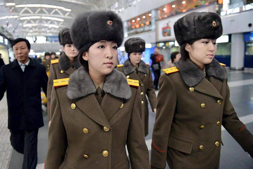 Some members of North Korea's all-female Moranbong Band arriving at Beijing International Airport yesterday for their flight home. The band had abruptly cancelled its concert in the Chinese capital.