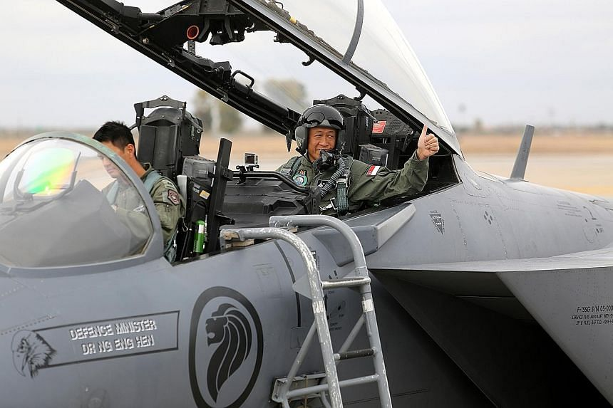 Defence Minister Ng Eng Hen preparing for take-off in an F-15SG piloted by Major Shewen Goh in Arizona, US. Dr Ng was there to observe how Singapore's air and ground troops worked together.