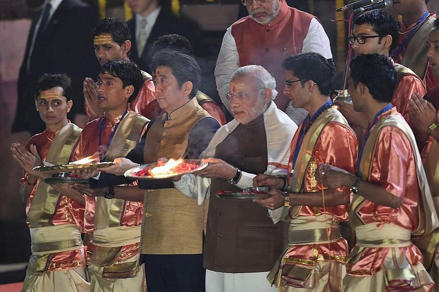 Japanese Prime Minister Shinzo Abe (centre left) and his Indian counterpart Narendra Modi (centre right) during the evening Aarti ritual on the banks of the River Ganges at Varanasi yesterday.