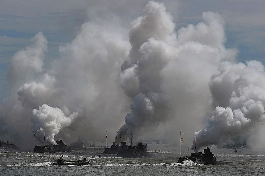 Indonesian navy vessels taking part in an anti-terrorism drill off the shore of Banda Aceh in Aceh province yesterday. Eleven warships were involved in the exercise ahead of the country's Archipelago Day today.