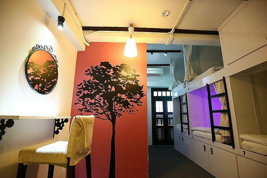 Wink Hostel, which opened in 2011 in Chinatown, is believed to be the first capsule hostel here. Sleeping spots (right) have room for a ledge, and spacious lockers for luggage. Each capsule measures about 1.2m in height and width, and is about 2m lon