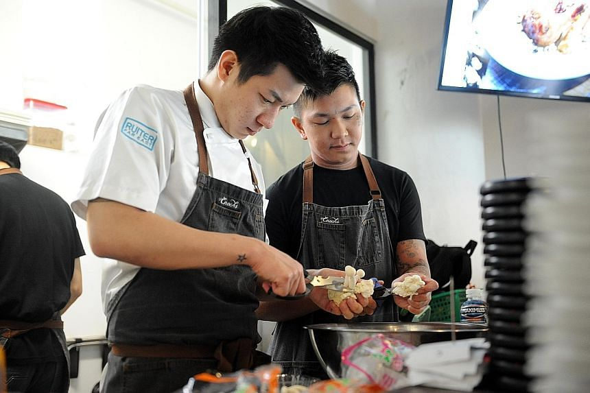 Mr Enoch Teo (left), one of the two founders of E&I Food Concepts, is a former at-risk youth. E&I runs three food outlets.