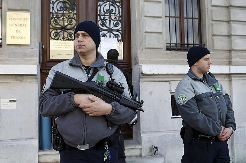 Swiss police officers standing guard outside the French consulate in Geneva on Friday.