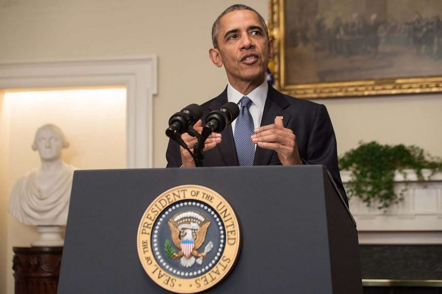 US President Barack Obama delivers a statement in the Cabinet Room at the White House in Washington after an international climate accord was reached in Paris.