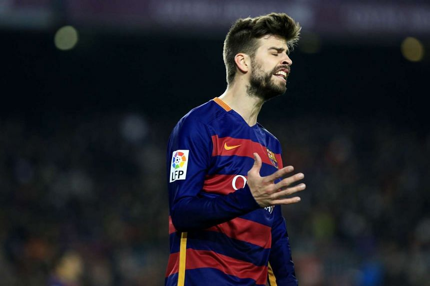 Barcelona defender Gerard Pique gestures after a failed attempt on goal.